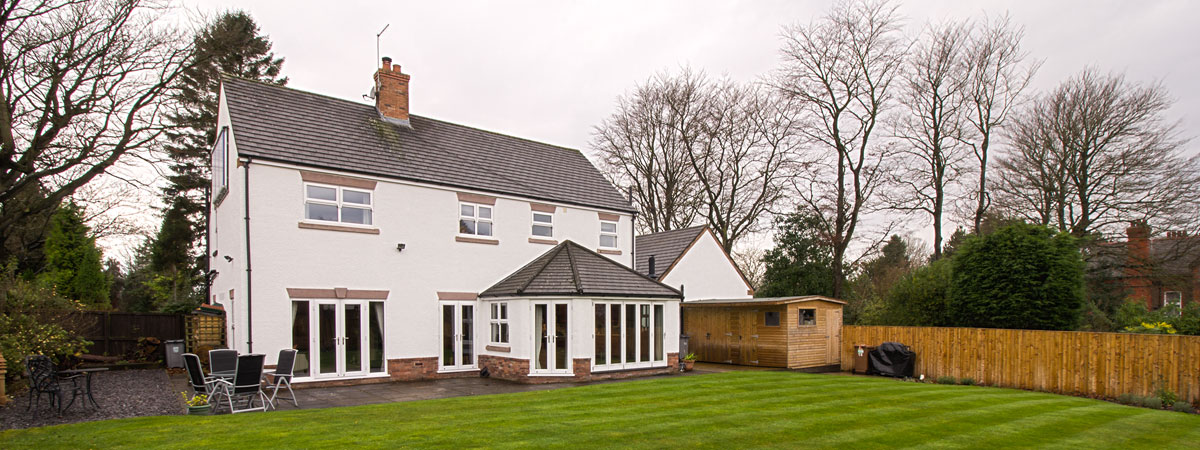 Banner image showing the rear of property with full house installation of Mock Sash UPVC windows.