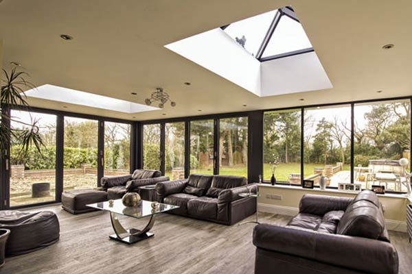 Modern orangery with aluminium windows and roof lights.