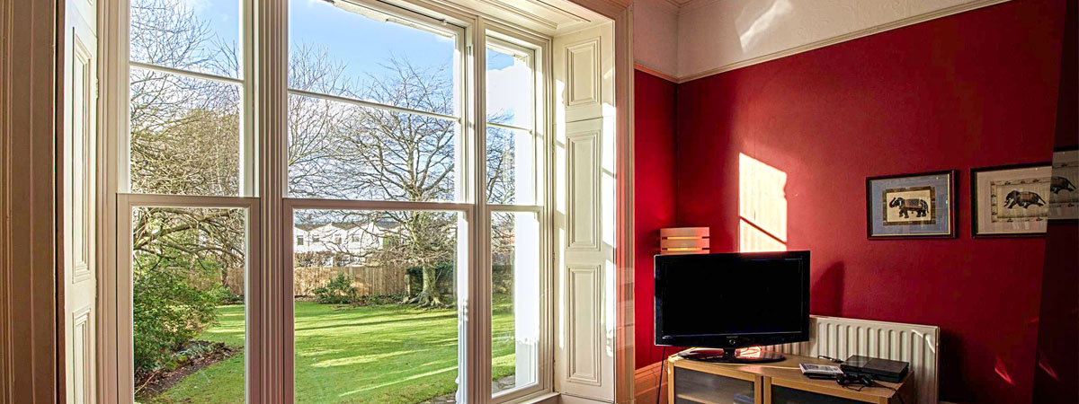 Internal view of triple sash windows from Roseview overlooking garden from living room.