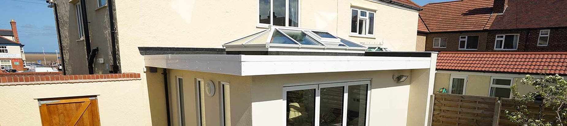 Traditional orangery with white aluminium roof lantern.
