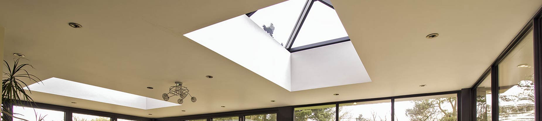 Double modern grey aluminium roof lanterns installed in Wirral, featuring modern glazing bars and triple glazing.