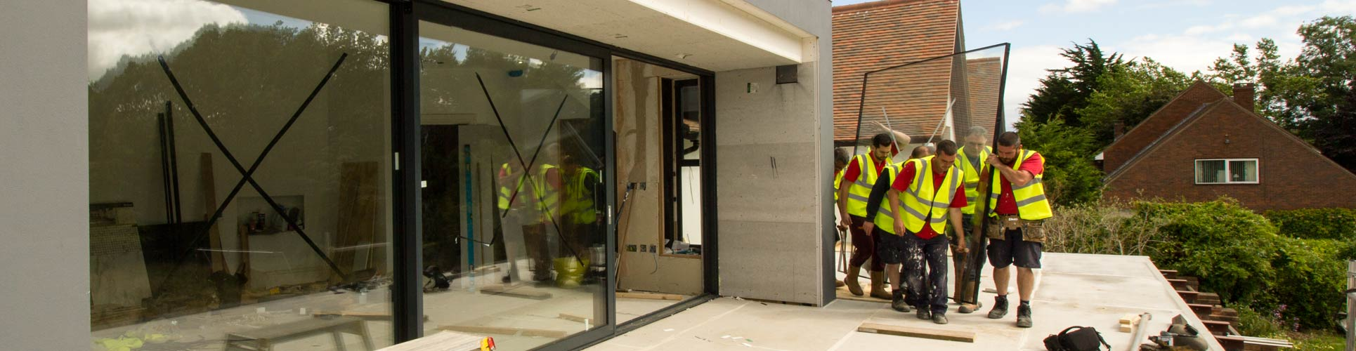 Black 9m Dutemann sliding door installation in Caldy, Wirral.