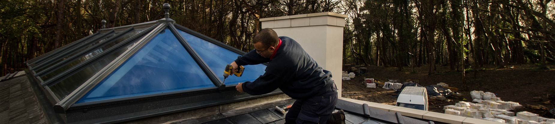 Picture of one of our installers Carl fitting one of our top of the range aluminium roof lanterns.