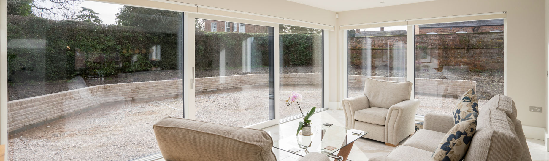 Garden room fitted with dual large alu clad sliding doors.