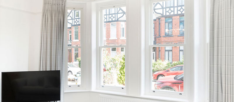 Sash windows fitted with architrave banner.