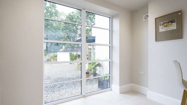 Internal view of the steel alternative aluminium doors in white with matching handle and horizontal glazing bars.