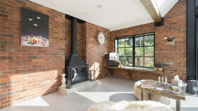 Another part of this large living area fitted with an authentic Crittall steel window.