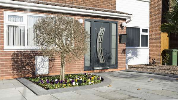 Aluminium entrance door from Spitfire supplied and installed in Wirral, featuring curved design and handle.