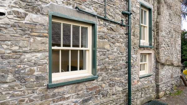 Three alu clad sash windows supplied in a yellow/beige colour to match the exisitng timber windows.