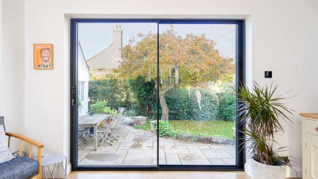 Striaght on view of our Knight Line aluminium sliding door.