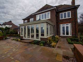 Corner view of this stunning conservatory set in landscaped gardens.