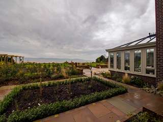 Making the most of the view with this garden room blending in perfectly with its surroundings.