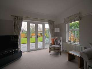 Interior shot of mock sash window and french door overlooking garden.