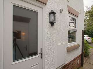 Composite side door and single window.