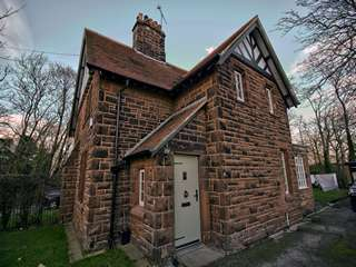 Full house view of Roodee cottage featuring timber effect windows and entrance door.