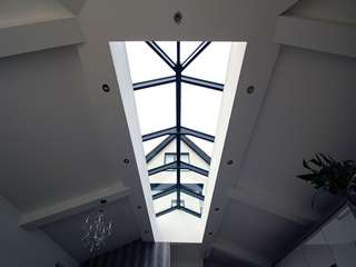 Internal shot of the aluminuium roof lantern looking up at the grey aluminium windows in Cheshire.