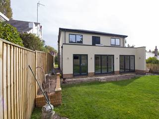 External view of full house installation of Grey aluminium windows and doors.