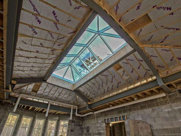 Internal shot of aluminium roof lantern installation showing structual elements of the roof.