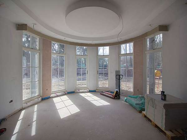 Rounded bay window progress, windows looking much better with some plaster and paint.