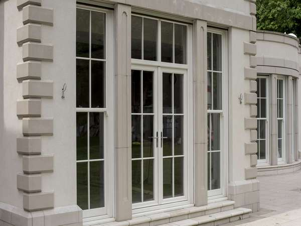 Close up detail shot of the Evolution timber french doors with top lights and Bygone sash windows to either side.