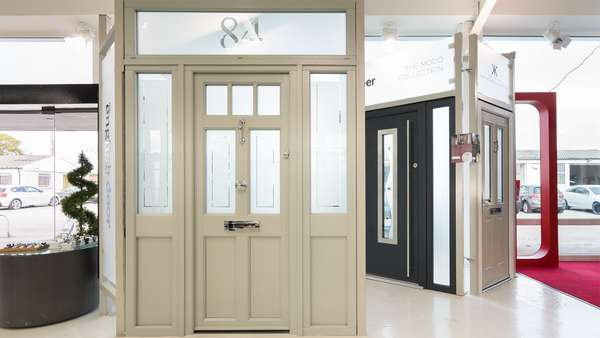 Traditional entrance door with top and side lights, complete with number etching.
