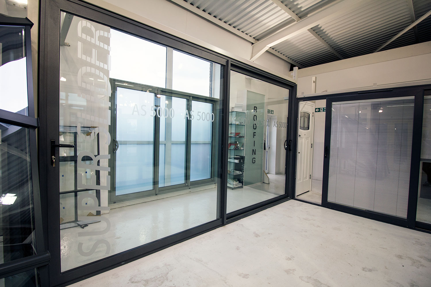 Aluminium sliding doors john knight glass heswall uk for Large sliding glass doors for sale