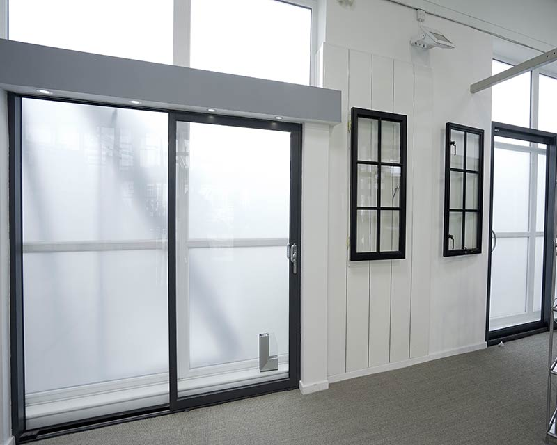 Green Allstyle aluminium sliding door on display.