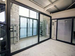 Large Allstyle aluminium slidign door in grey.
