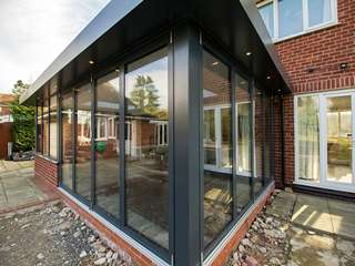 Corner view of dual Centor bifold doors great for opening the internal space to the outside world for summer days and holidays.
