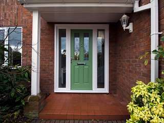 Main entrance door in green with chrome hardware, Lead lights, side lights and UPVC frame.