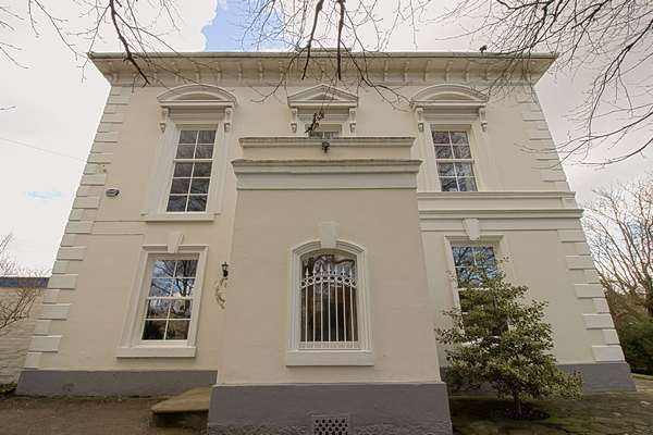 Close up of side entrance to property showing 5 extremely large sash windows with period correct glazing bars.