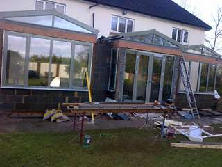 Various aluminium products installed in light green to complete custom orangery build.