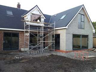 Aluminium windows and doors supplied in Grey RAL 7016, all windows from the AMS range.