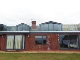 Installation of AMS aluminium windows in grey to complete this property development.
