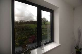 Internal view of aluminium window replacement in grey to match windows throughout the extension.