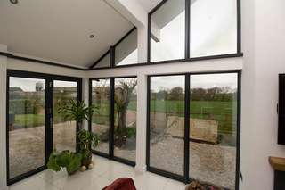 Alternative corner shot showing aluminium windows and Centor bifold doors.