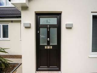 Black timber alternative entrance door with feature top light and chrome hardware.