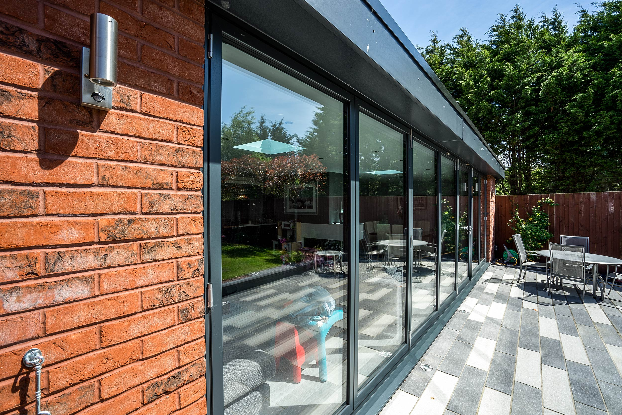 External close up of Aluminium bifold doors allowing lots of Natural light to flood into this property on the Wirral. & Aluminium Doors Wirral | John Knight Glass