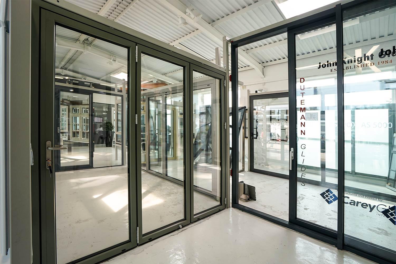 Aluminium doors john knight glass nw uk for Multi panel sliding glass doors