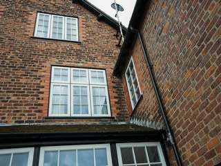 Various windows throughout the rear of the property updated to Evolution timber alternative windows.