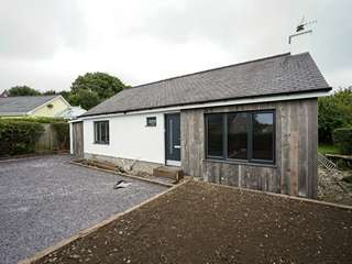Main shot of detached Bungalow in Criccieth, Wales featuring Rationel Slimline alu-clad windows and doors.