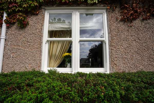 External view of dual sliding sash window installation in Heswall, Wirral.