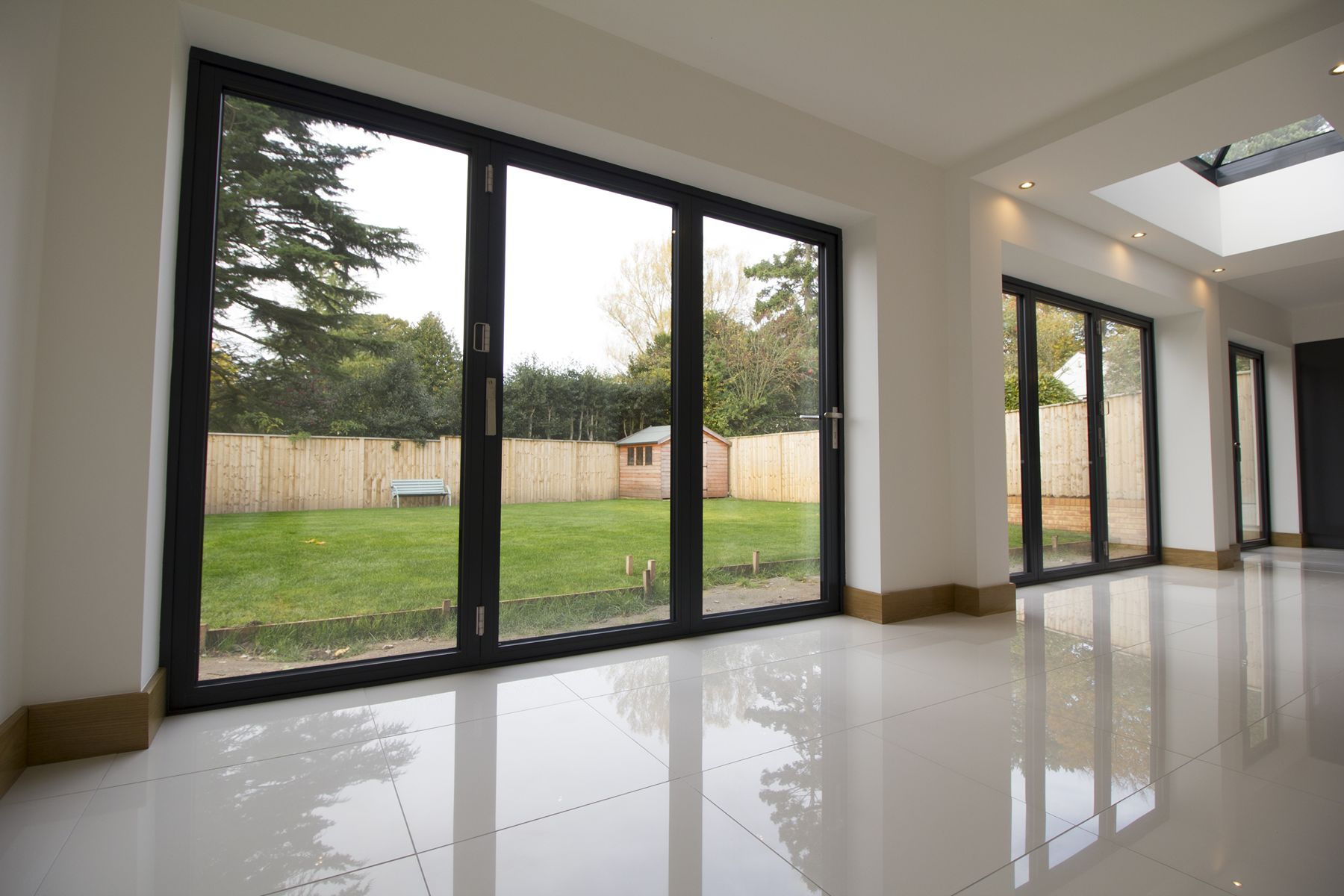 Triple aluminium bifold door installation Wirral. & Why Choose Centor Bifolding Doors | Centor Bifolds | John Knight Glass