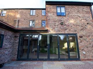 External view of 6 leaf aluminium bifold door installation.