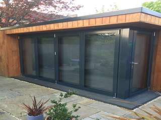 Installation of corner bifold doors in timber garden room.