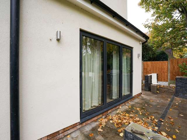 Tripple bifold doors allowing access to the rear entertaining area.