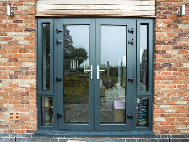 Aluminium french doors in RAL 7016.