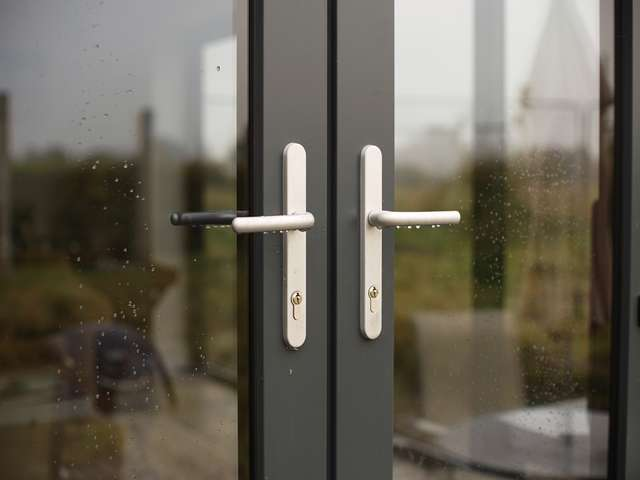 Close up of handles on aluminium doors.