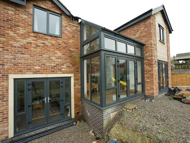 Feature glazed area maximising on light and view of the stunning landscape at the rear of the property.