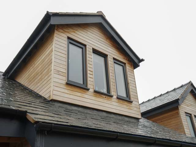 Close up of dormer window with triple aluminium casement windows.